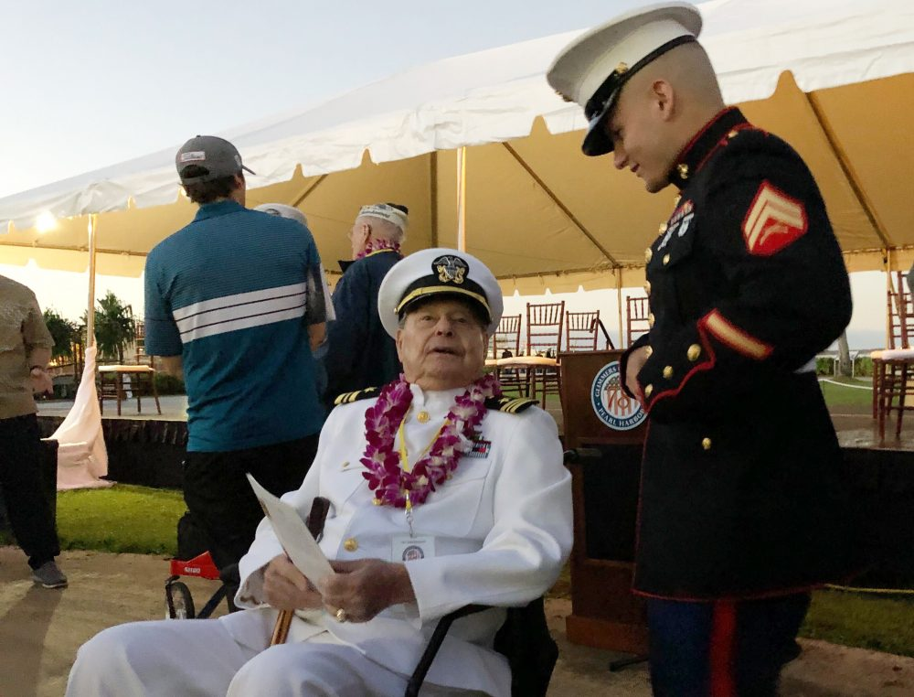 Marine Cpl. Zachariah Jeavons, 22, of Binghamton, N.Y., meets Pearl Harbor survivor Lou Conter, 98, who was aboard the USS Arizona when the Japanese attacked in 1941, Saturday at Pearl Harbor, Hawaii on the 78th anniversary of the attack.