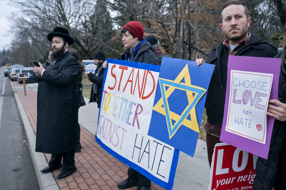 Neighbors gather to show their support of the community near a rabbi's residence in Monsey, N.Y., Sunday, Dec. 29, 2019, following a stabbing Saturday night during a Hanukkah celebration. (AP Photo/Craig Ruttle)