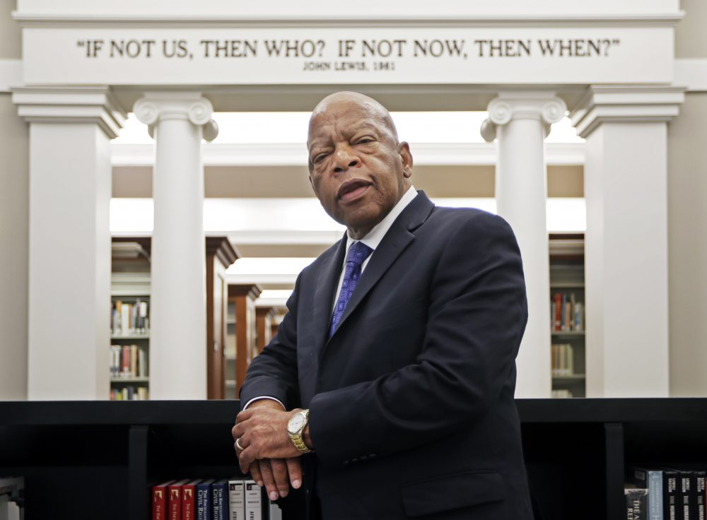 U.S. Rep. John Lewis, D-Ga., stands for a photograph under a quote of his displayed in the Civil Rights Room in the Nashville Public Library in Nashville, Tenn. Lewis announced Sunday that he has stage IV pancreatic cancer, vowing he will stay in office and fight the disease with the tenacity which he has fought racial discrimination and other inequalities since the civil rights era.