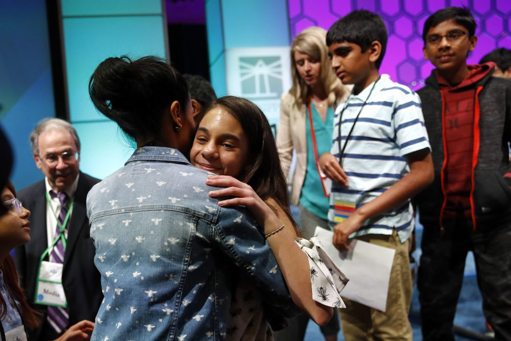 In this Thursday, May 30, 2019, file photo, Simone Kaplan, of Davie, Fla., hugs her mother, Alana, as she walks offstage after reaching the final round of the Scripps National Spelling Bee, in Oxon Hill, Md. The Scripps National Spelling Bee will have fewer participants in 2020, as organizers are reducing the number of wild-card entrants.