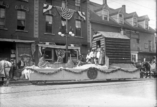 A float featuring a Pilgrim trading post during one of many parades held to celebrate Maine's centennial in 1920.