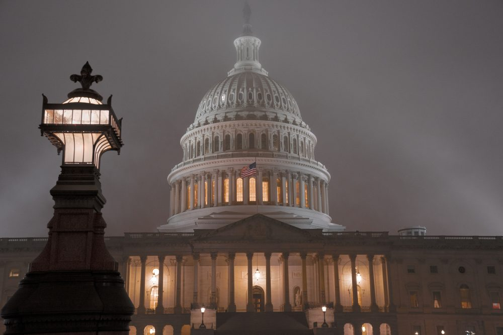 The U.S. Capitol in Washington shrouded in mist. The $1.4 trillion government-wide spending package the House passed Tuesday will forestall a government shutdown this weekend and give President Trump steady funding for his U.S.-Mexico border fence.