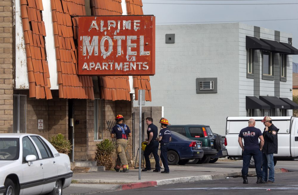 Las Vegas firefighters work the scene of a fire at a three-story apartment complex early Saturday. The fire was in first-floor unit of the Alpine Motel Apartments and its cause was under investigation, the department said.  Authorities say multiple fatalities were reported and several were injured.