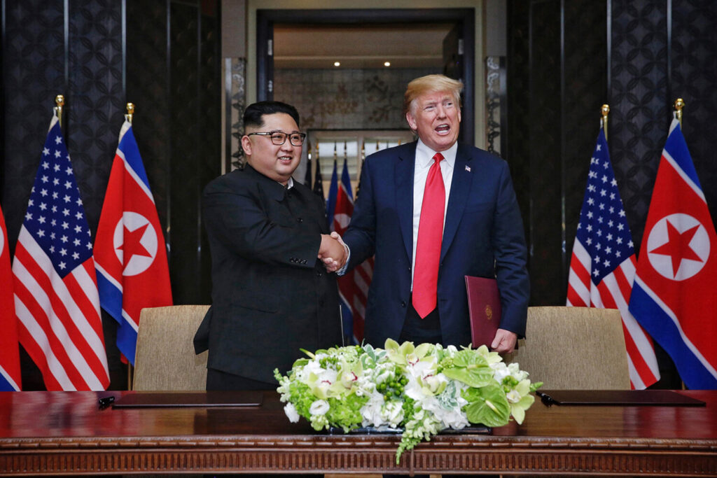 President Donald Trump and North Korean leader Kim Jong Un shake hands after signing an agreement at the Capella Hotel on June 12, 2018, in Singapore.