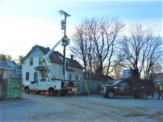 A worker for Wiswell Electric of Clinton installs an LED streetlight on Wentworth Court near the Waterville Public Works complex recently.