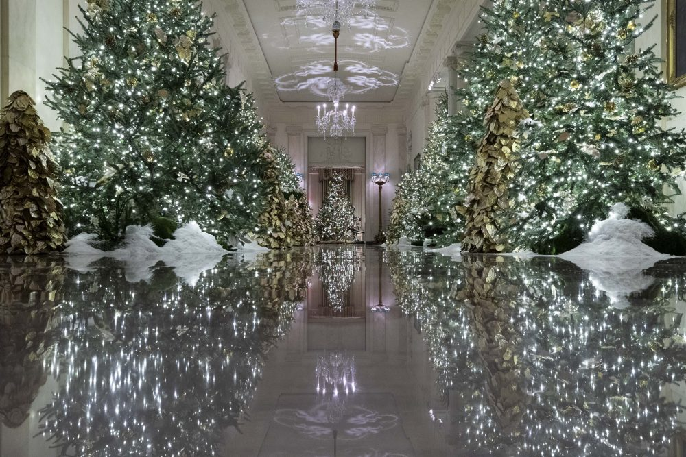 The Cross Hall leading into the State Dinning Room is decorated during the 2019 Christmas preview at the White House, Monday.