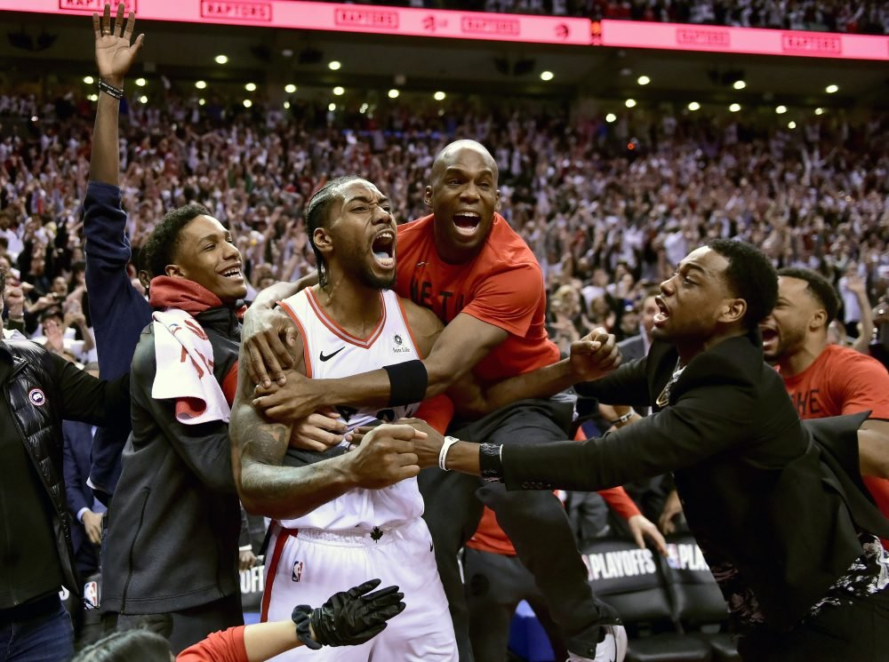 Kawhi Leonard, second from left, did it all last season for the Toronto Raptors, including a crazy shot to win Game 7 of the Eastern Conference semifinals against the Philadelphia 76ers. His big season earned his AP male athlete of the year honors.