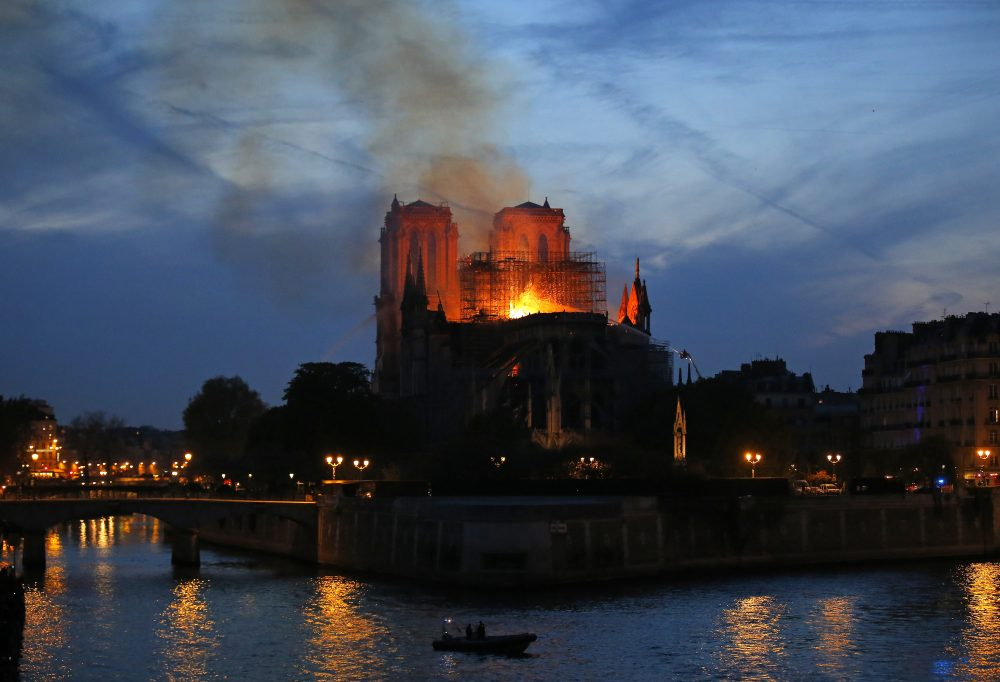 Flames and smoke rise from Notre Dame in Paris as firefighters tackle the blaze on April 15.