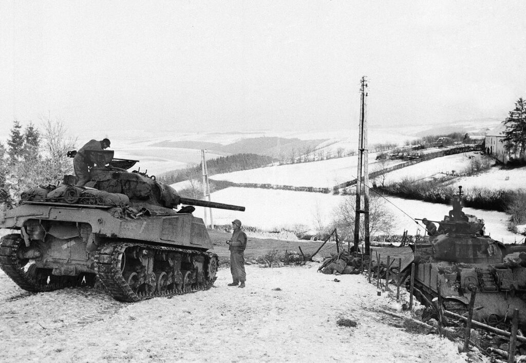 American tanks wait on the snowy slopes in Bastogne, Belgium, on Jan. 6, 1945. It was 75 years ago that Hitler launched his last desperate attack to turn the tide for Germany in World War II.
