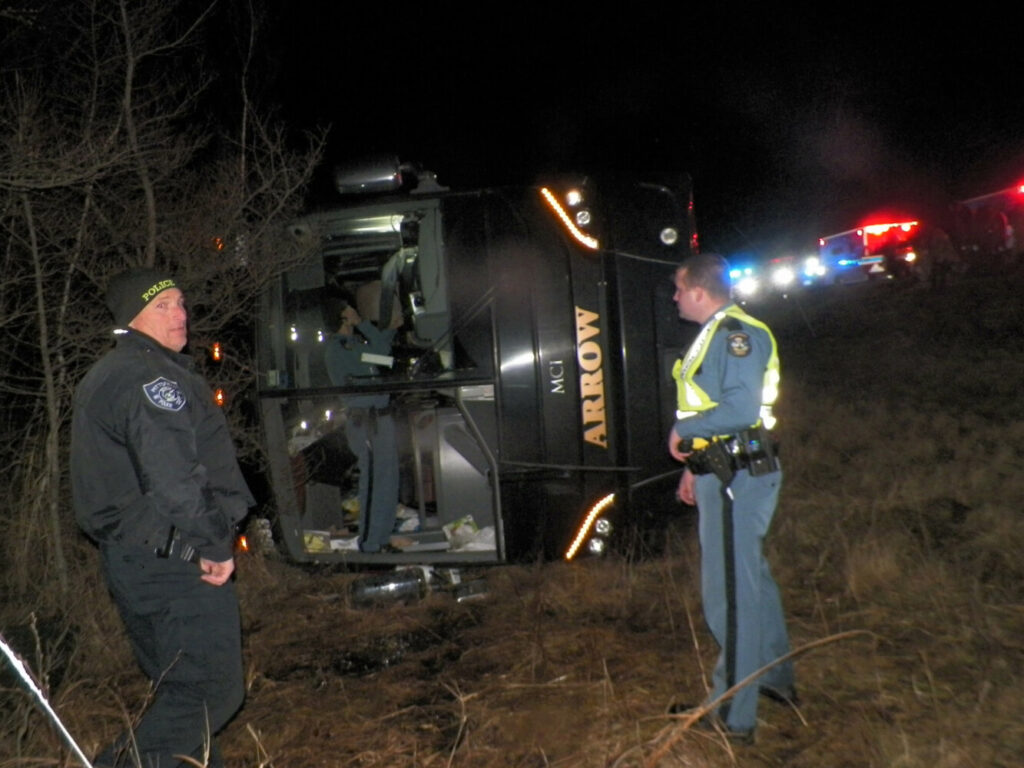 Maine State Police troopers respond to the scene of a bus crash on I-95 in Burnham late Tuesday night.
