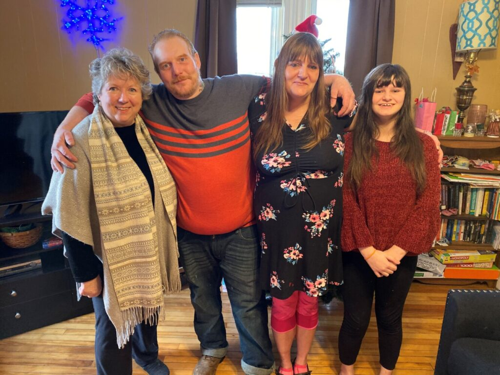 The Rev. Maureen Ausbrook, a minister with the Waterville United Church of Christ, was instrumental in finding shelter for Travis Dobson and Amy and Emily Pinkham. The family said their faith in God helped them through the hard times.
