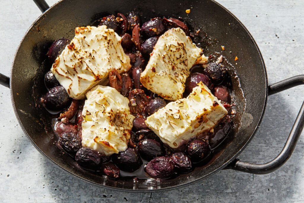 Roasted Feta with Grapes and Olives. An easy-peasy appetizer.
