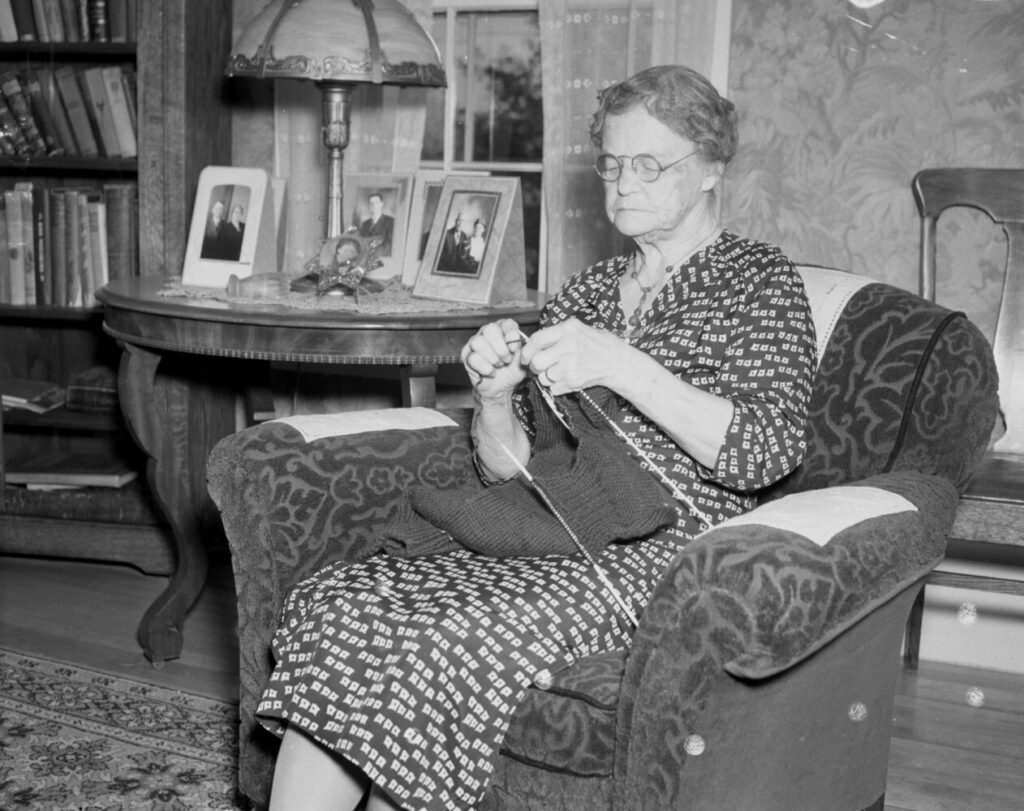 Dec 1941: Mrs. Minetta Paul, of Rockport knits for the troops in the days following Pearl Harbor.