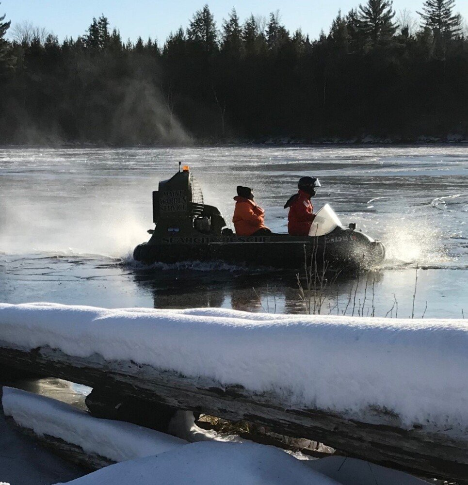 Game Warden Sergeant Ron Dunham maneuvers a hovercraft over the thin ice and towards shore after rescuing a stranded hunter on the river