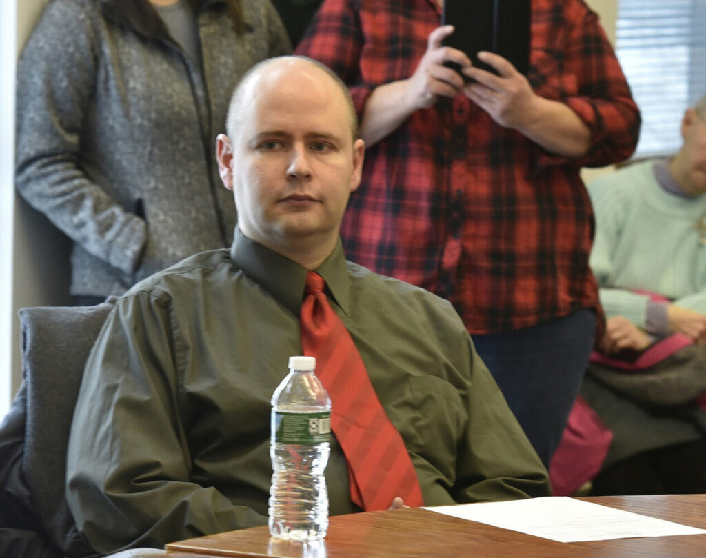 Jackman Town Manager Thomas Kawczynski awaits the announcement by selectmen during a meeting attended by 50-town residents on January 23, 2018.