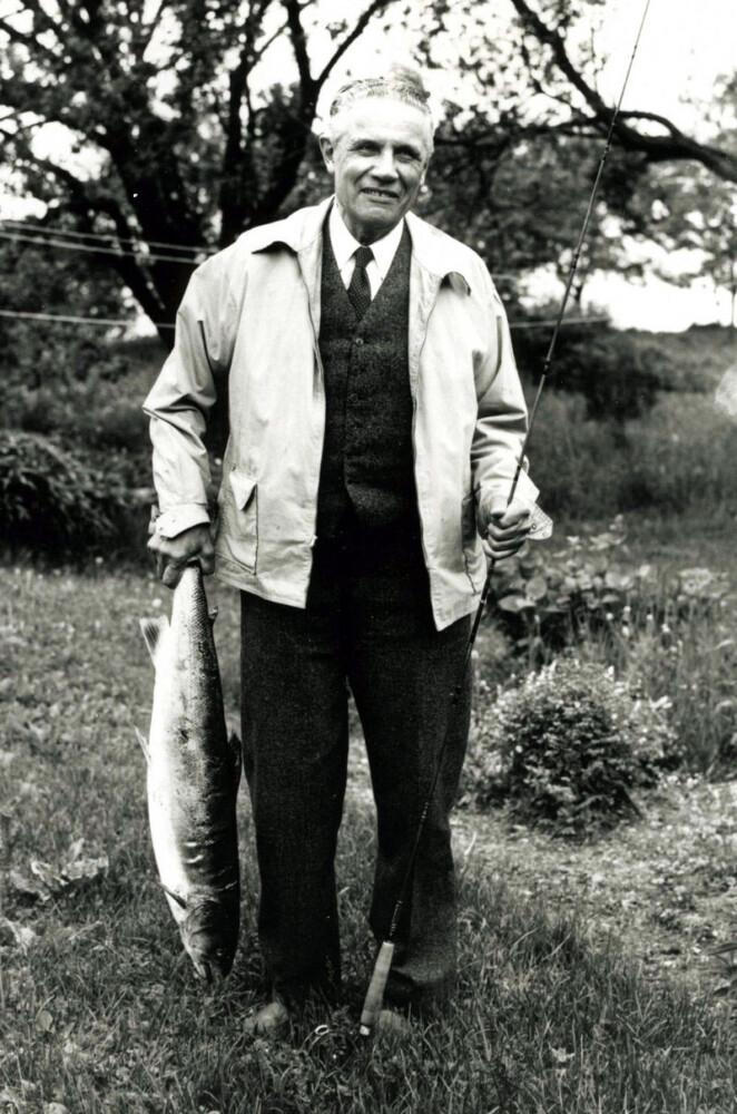 Leon Leonwood Bean holds a 19-pound salmon in New Brunswick, Canada, in 1945.
