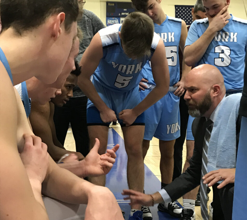 York Coach Paul Marquis instructs his team during a late-game timeout. York beat host Falmouth 68-63 Tuesday to remain unbeaten in Class A South.