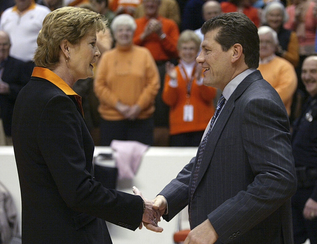 FILE - In this Jan. 7, 2006, file photo, Tennessee coach Pat Summitt, left, shakes hand with Connecticut coach Geno Auriemma before an NCAA college basketball game in Knoxville, Tenn. Connecticut's path to a third straight national championship could include a renewal of the most heated rivalry in women's college basketball. For Auriemma to match Summitt with an eighth national championship he might have to go through her Lady Vols, who earned the top seed in the Dayton region. If both come through their regions, UConn and Tennessee could meet again in the national semifinals at Indianapolis. (AP Photo/Wade Payne, File)