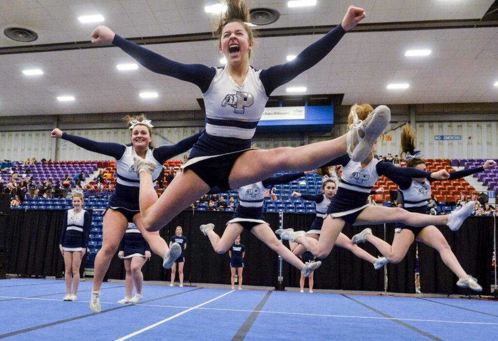 Portland competes in Class A North regional cheering on Saturday at the Augusta Civic Center.