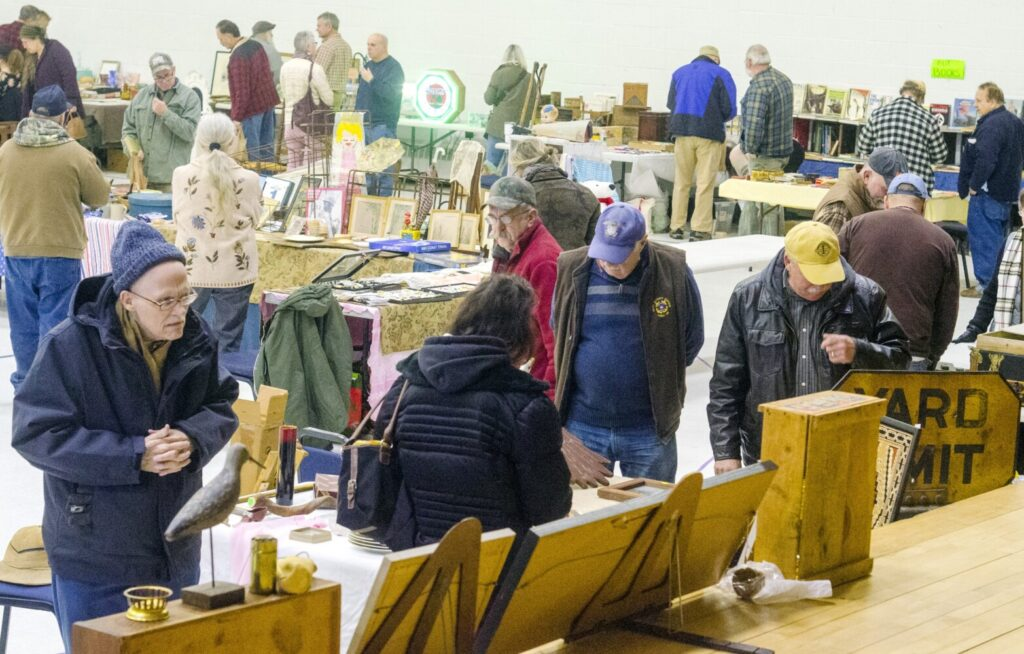 People browse Wednesday during the annual New Year's Day antiques show at the Augusta Armory. Organizer James Montell said that it was the first show of the state's bicentennial year.