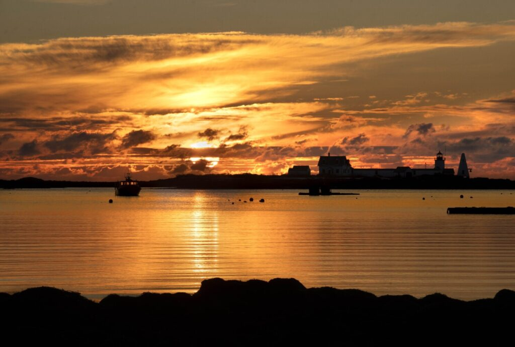 CAPE PORPOISE, ME - JANUARY 1: The sun rises behind Goat Island lighthouse in Cape Porpoise at dawn on New Year's Day, January 1, 2020. (Staff Photo by Gregory Rec/Staff Photographer)