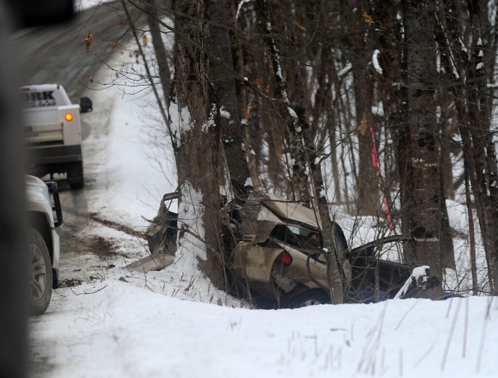 A vehicle left the roadway, pictured in the background, in the vicinity of the Strickland and Pinnacle roads and smashed into a tree in Canaan on Thursday.