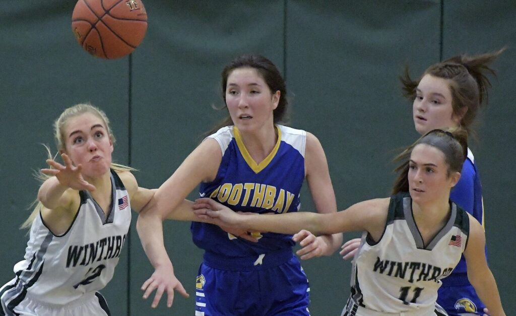 Winthrop's Natalie Frost, left, and Jillian Schmelzer pursue the ball with Boothbay's Madison Forgue on Wednesday in Winthrop.