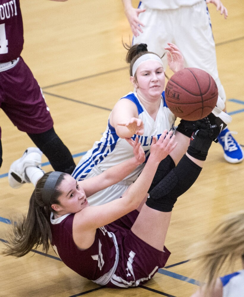 Madison's Brooke McKenney, left, battles for the loose ball with Monmouth's Abby Flanagan during a game Friday in Madison.