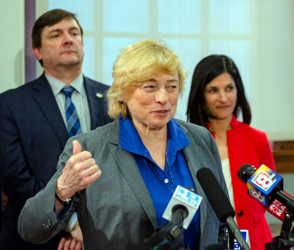 Gov. Janet Mills speaks as Senate President Troy Jackson and House Speaker Sara Gideon listen at Wednesday's news conference announcing Democrats' sweeping health care bill for the coming session.