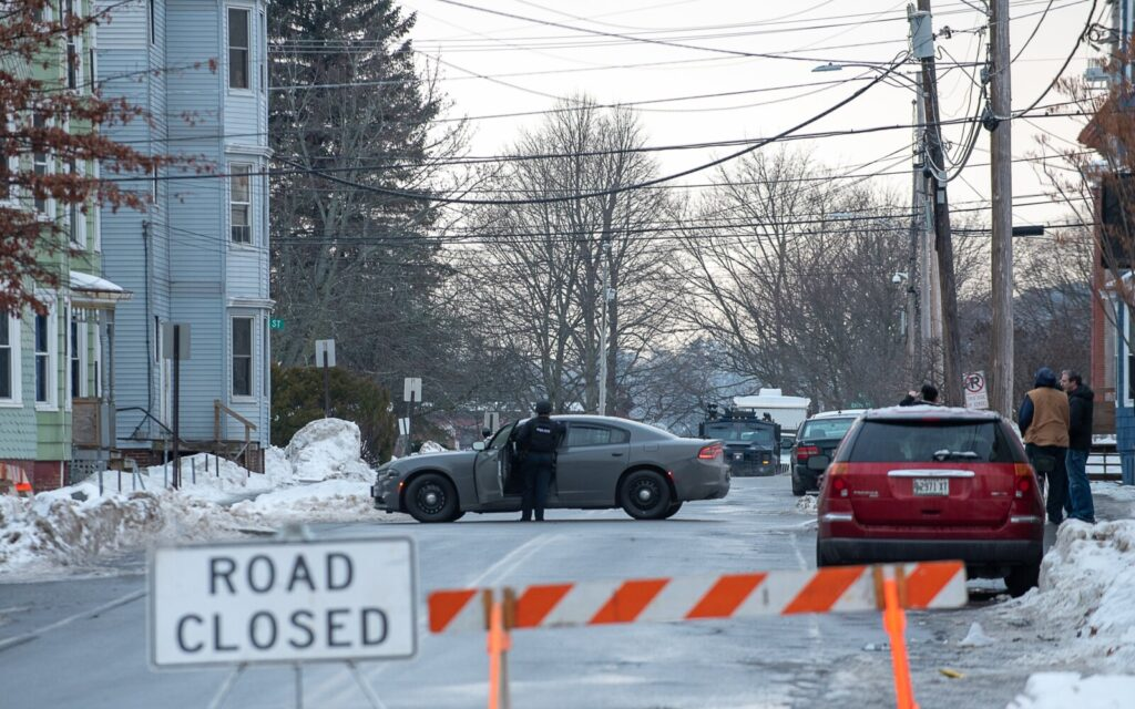 Dozens of local and state police units surrounded 21 Walnut St. in Lewiston early Saturday morning during a standoff. Three people were arrested Sunday in connection with the incident.