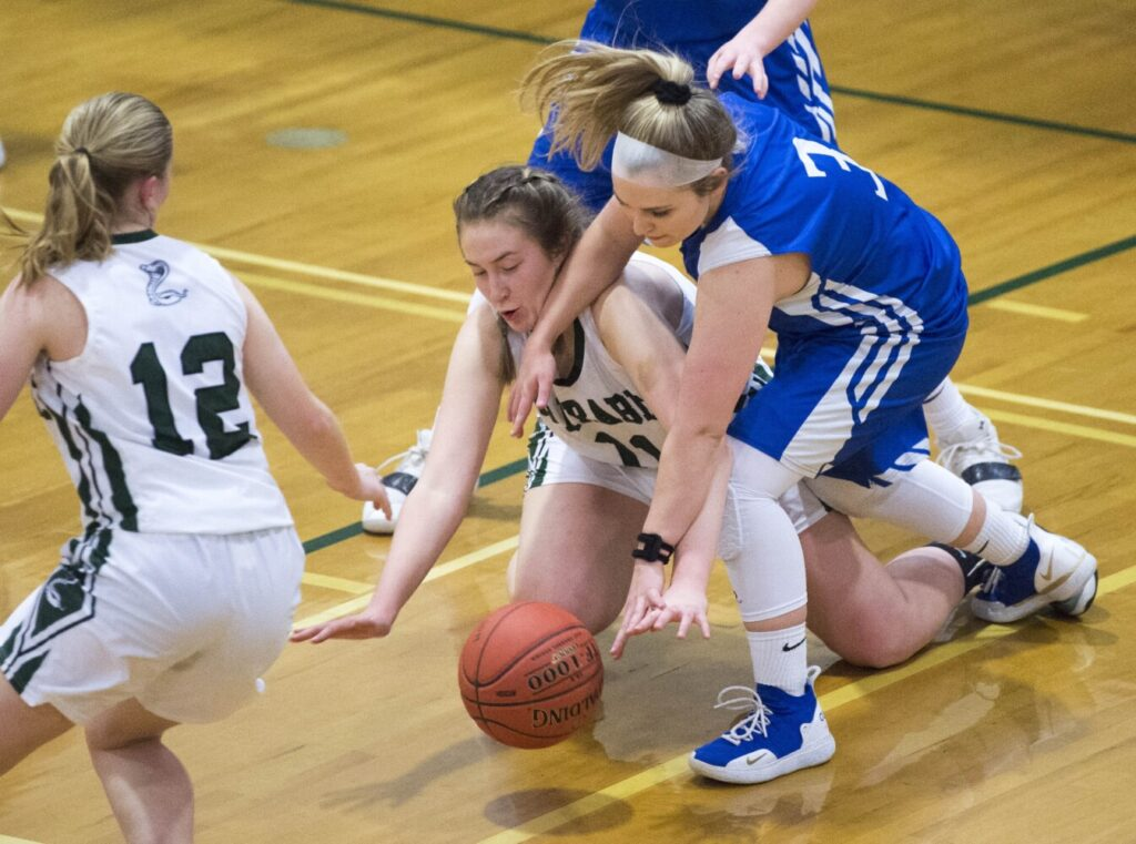 Carrabec's Cheyenne Cahill (11) battles for the loose ball with Madison's Lauria LeBlanc (3) in a Mountain Valley Conference game Wednesday in North Anson.