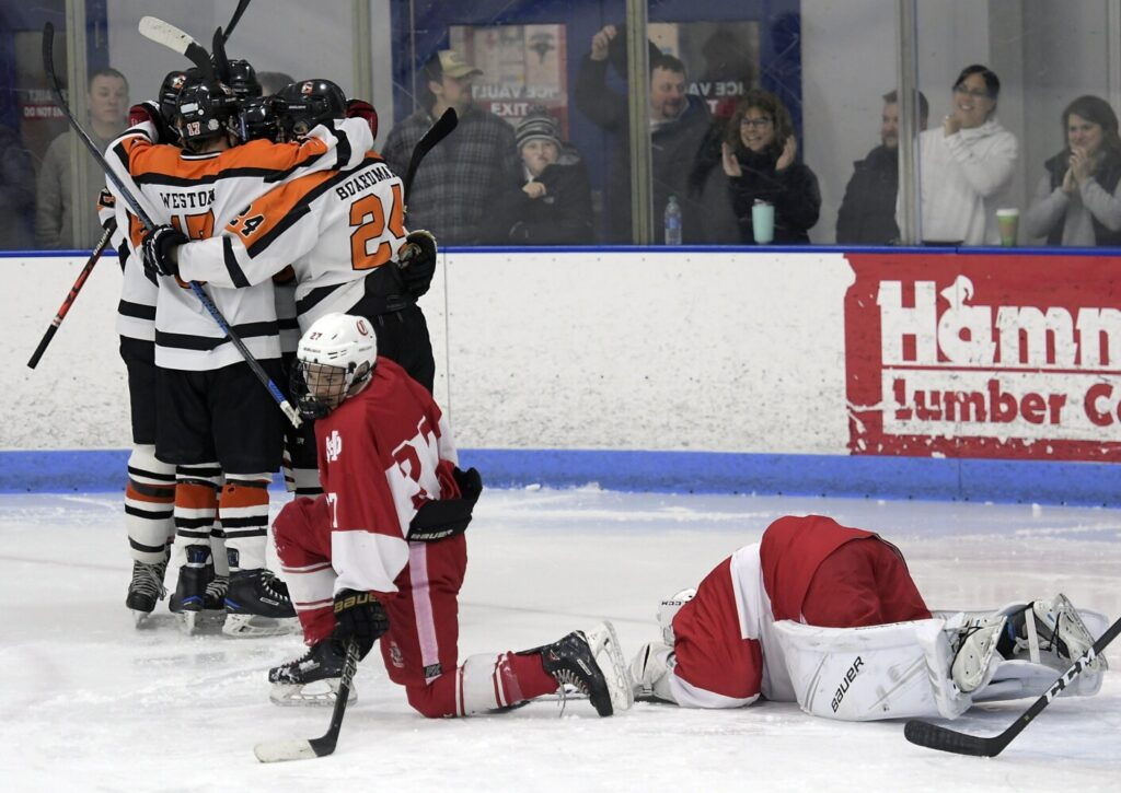 Cony High School's defense reacts to a goal by Gardiner Area High School during a hockey game on Thursday  in Hallowell.