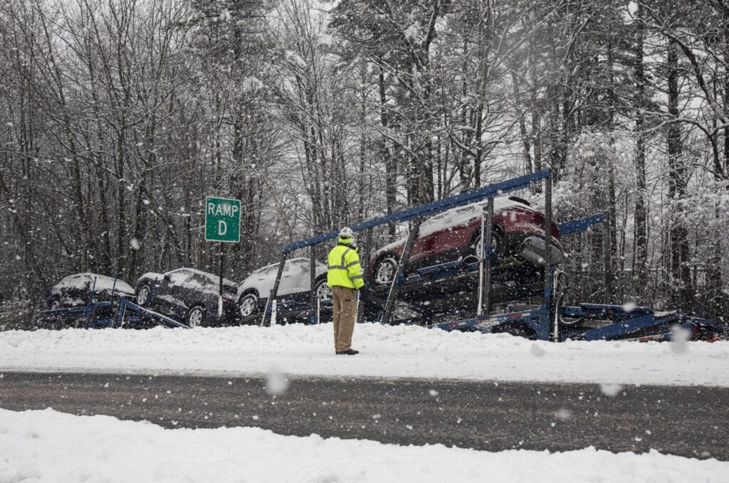 A tractor-trailer carrying cars went off the road on a ramp near Interstate 295 in South Portland during the snowstorm Thursday.