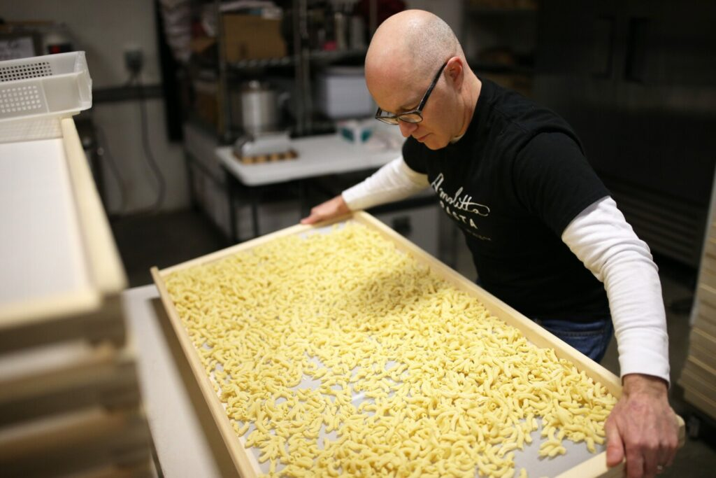 Andrew Steinberg, owner of new Portland-based business Amolitta Pasta prepares fresh torchietti for drying. The number of food and drink entrepreneurs in Maine continues to grow at a steady clip.