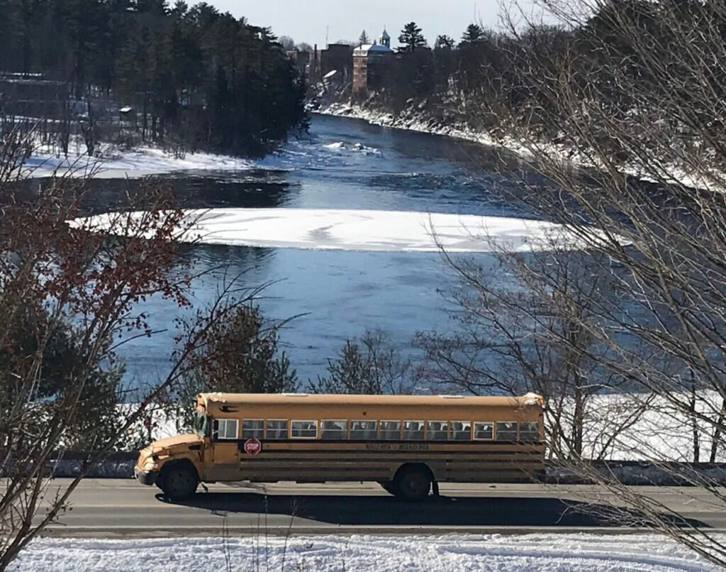 A school bus passes an ice disk Tuesday that floats at the Great Eddy of the Kennebec River off  U.S. Route 2 in Skowhegan.