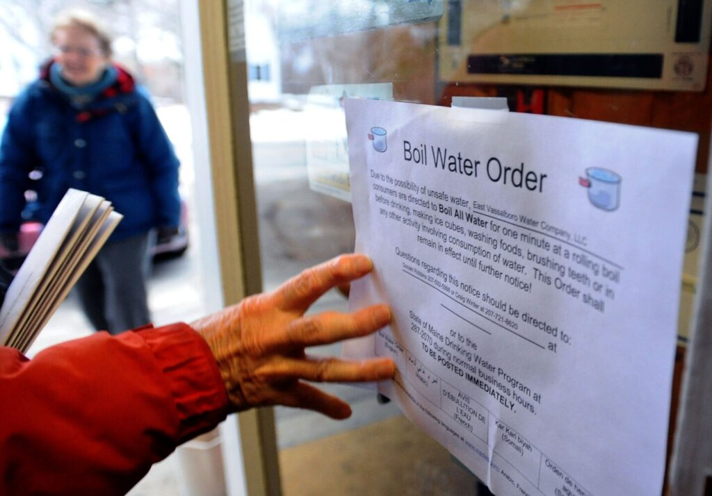 Patrons of the East Vassalboro post office are informed of a boil water order that was displayed on the door Tuesday.