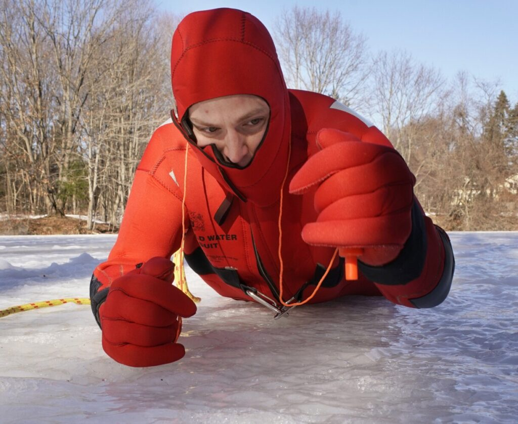 Ben Guild, a firefighter and paramedic with the South Portland Fire Department, demonstrates how to use hand pick to pull oneself back onto ice after falling through a hole. Guild went through the ice on a snowmobile on Rangeley Lake in 2011.