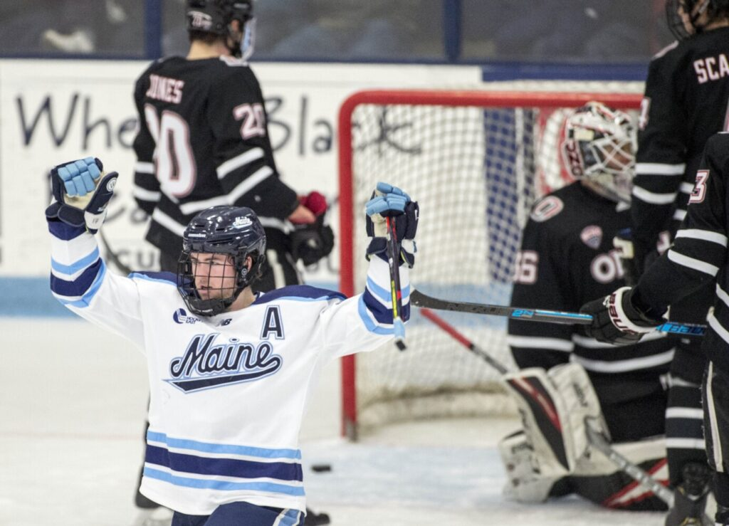 Tim Doherty, left, celebrates a goal against University of Nebraska Omaha in the second period at Alfond Arena at the University of Maine in Orono on Friday.