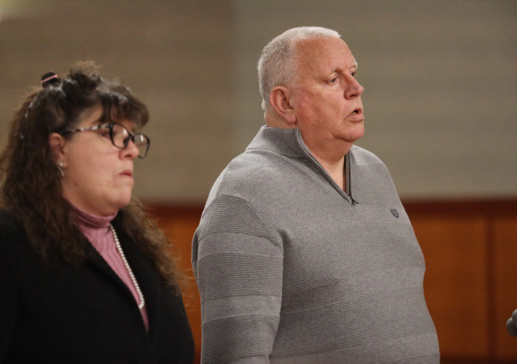 Kenneth Morang, a former corrections officer, pleaded not guilty Monday to manslaughter in a crash that killed a 9-year-old girl in Gorham in July. Morang told police he fell asleep at the wheel after a series of overtime shifts at the jail in the preceding days. Standing next to Morang in court is his attorney, Amy Fairfield.