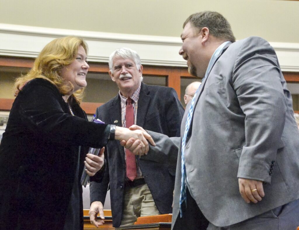 Chief Justice of the Maine Supreme Judicial Court Leigh Saufley, left, greets Rep. Billy Bob Falkington, R-Winter Harbor, right, as Rep. Richard Campbell, R-Orrington, looks on prior to her State of the Judiciary address, Tuesday in the Maine State House's House of Representatives chamber in Augusta.