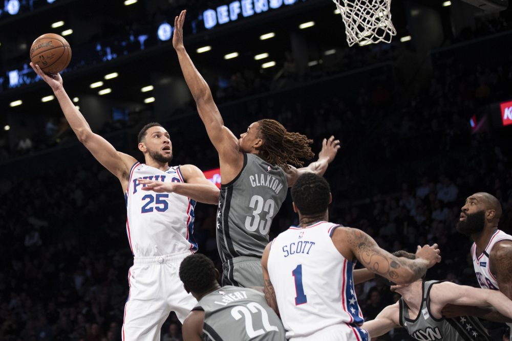 Philadelphia's Ben Simmons goes to the basket against Brooklyn's forward Nicolas Claxton during the 76ers' 117-111 win Monday in New York.