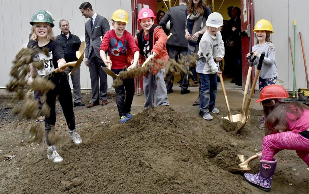 Lilly Howe, from left, Angus Johnson, Nikolai Fay, Silver Picard, Juliet Boivin and Isabella Veilleux got a chance to take part in a groundbreaking ceremony for the Alfond Youth Center Wellness project, flinging dirt toward the photographer on Nov. 1, 2019. The Waterville Planning Board gave conditional approval on Monday to the center to revise its traffic and pedestrian plan.