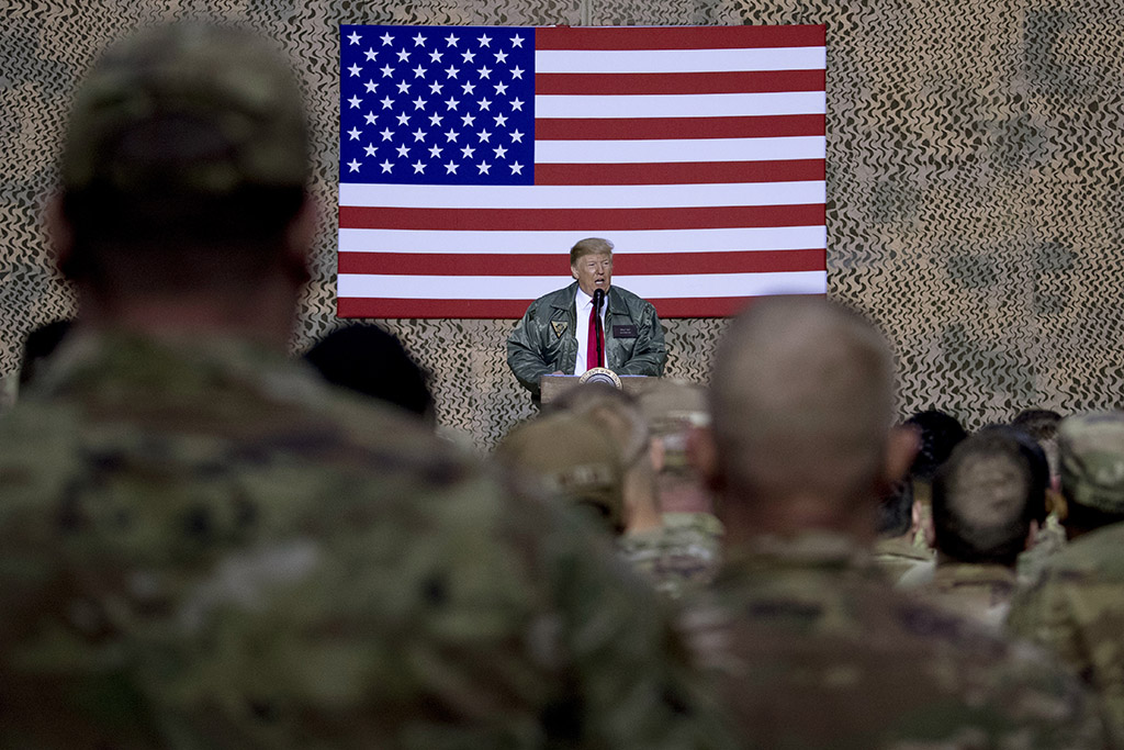 President Trump speaks to U.S. service members at the Ain al-Asad air base in Iraq on Dec. 26, 2018. Iran struck back at the United States for the killing of a top Iranian general by firing missiles at the air base early Wednesday.