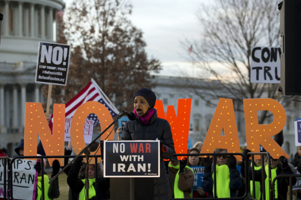 Rep. Ilhan Omar, D-Minn., speaks during the rally outside of the U.S. Capitol, where the House voted to pass a measure limiting President Trump's ability to take military action against Iran, in Washington on Thursday.