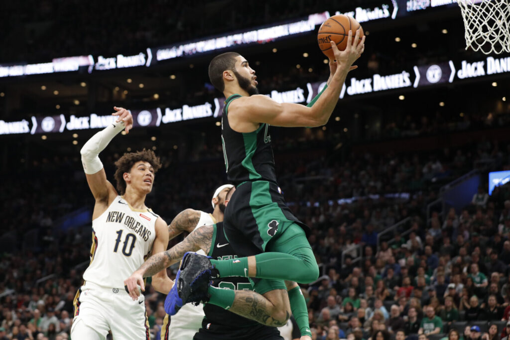 Boston's Jayson Tatum drives past New Orleans' Jaxson Hayes during the Celtics' 140-105 win Saturday in Boston. Tatum finished with a career-high 41.