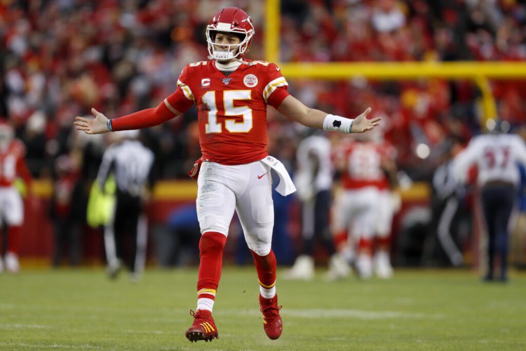 Kansas City quarterback Patrick Mahomes celebrates after throwing a touchdown pass during the second half of the Chiefs' 51-31 win over the Houston Texans in the AFC divisional round on Sunday in Kansas City, Mo.