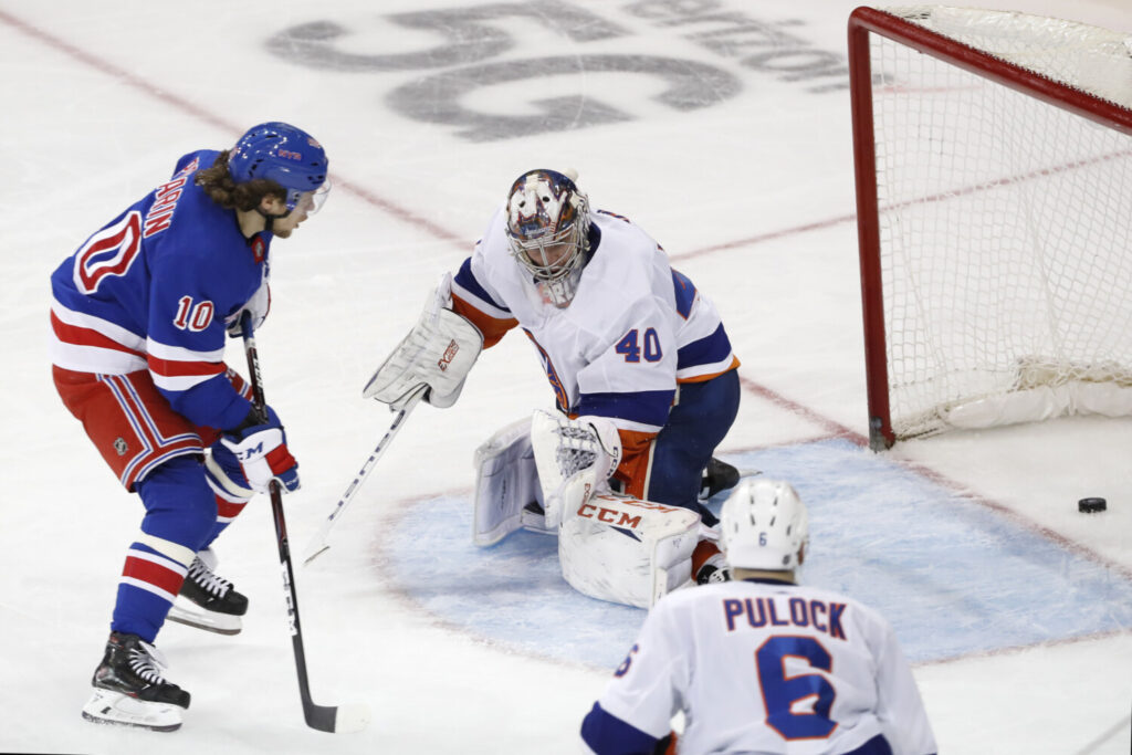 Rangers left wing Artemi Panarin watches his goal slide past New York Islanders goaltender Semyon Varlamov  during the third period of the Rangers' 6-2 win Monday in New York.