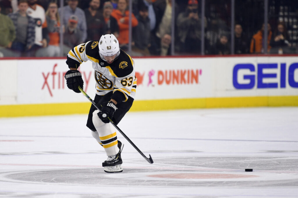 Boston's Brad Marchand misses the puck on his way to the goal on a shootout attempt on Monday against Philadelphia. Marchand didn't score and the Bruins lost 6-5.