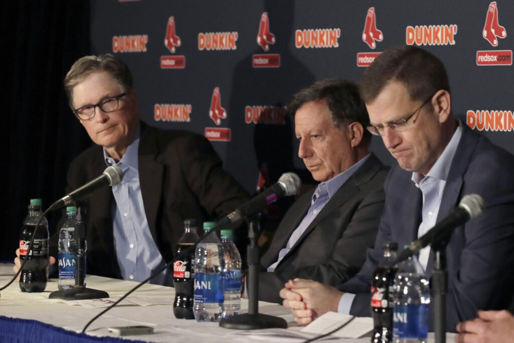 From left, Boston Red Sox owner John Henry, chairman Tom Werner and CEO Sam Kennedy hold a news conference at Fenway Park on Wednesday. The Boston Red Sox parted ways with manager Alex Cora one day after baseball Commissioner Rob Manfred named him as a ringleader with Houston in the sport's sign-stealing scandal.