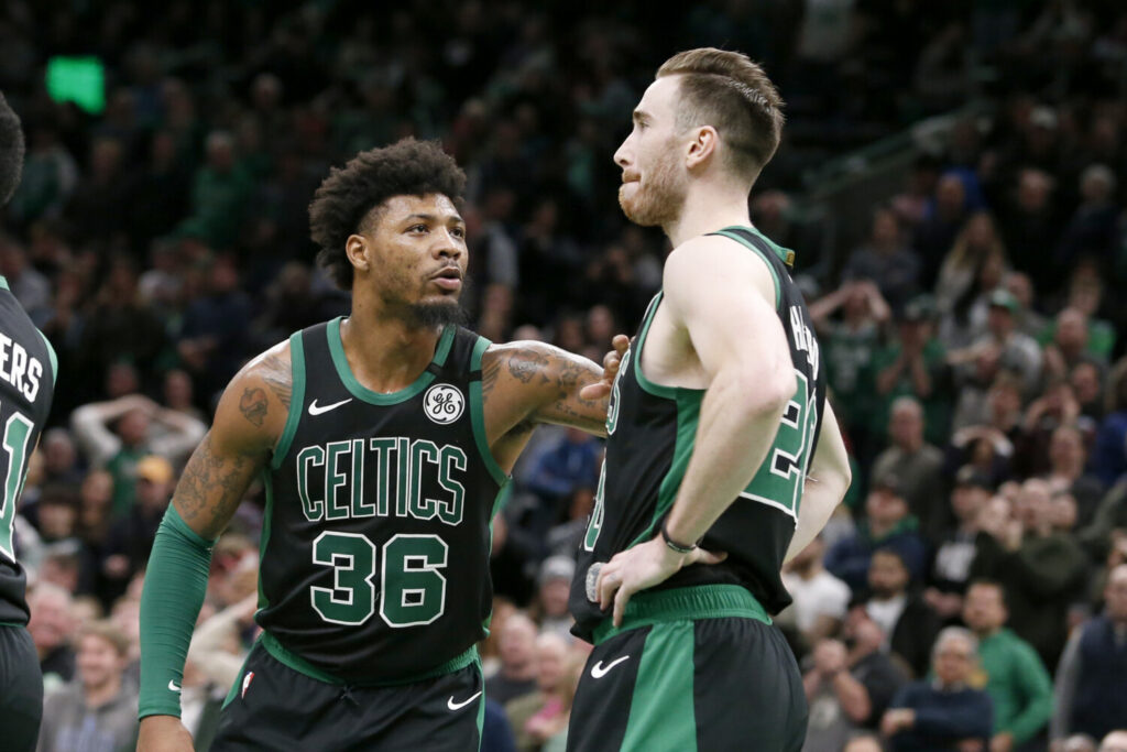 Celtics guard Marcus Smart gives teammate Gordon Hayward a tap after Hayward missed an easy layup on a lob from Smart late in the Celtics' loss to Phoenix on Saturday in Boston.